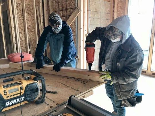 Field Supervisor Kirk Harms and lead carpenter Steve Drouillard work at a LaDuke Construction Lexington Township site on May 8, 2020.