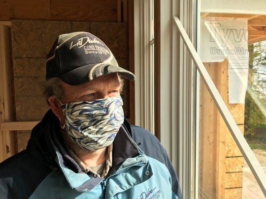 Kirk Harms, a field supervisor for LaDuke Construction, was able to get back to work on project sites after Gov. Gretchen Whitmer signed an executive order allowing construction companies to reopen operations in the state.