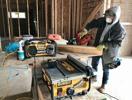Steve Drouillard, lead carpenter for LaDuke Construction on a Lexington Township project site, was able to restart project work after Gov. Gretchen Whitmer signed an executive order allowing construction companies to reopen operations in the state.