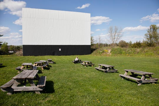 Co-owner of the Warwick Drive In Beth Seeber-Wilson sits among the picnic tables under movie screen one on Thursday May 7, 2020