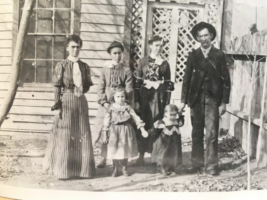 The Ritter family in front of the Magnolia House. Anna (left), William (right), (back) Adeline, Bernice and Addie and Minnie (front).