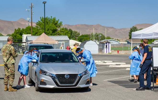 Local residents are tested for COVID-19 at Yerington High School.