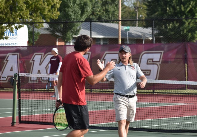 Jacob Rankin (right) takes over as Indiana University East's head tennis coach after a year as an assistant.