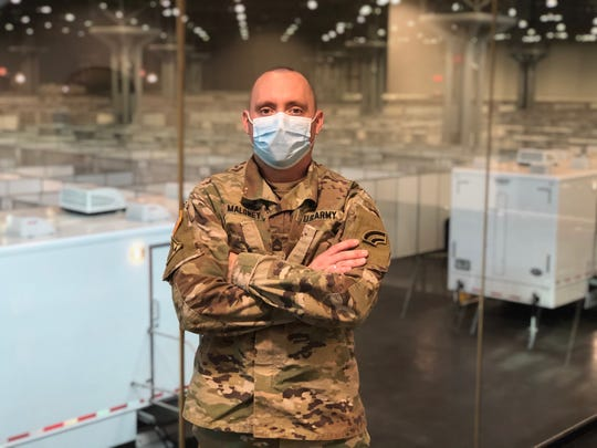 New York Army National Guard Sgt. 1st Class Joseph Maloney of Irondequoit inside a COVID-19 field hospital set up inside New York City's Javits Center.