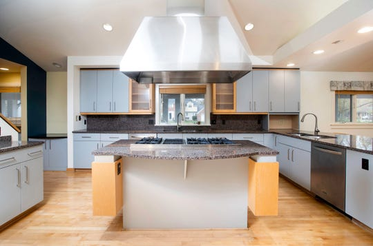 A large kitchen with updated appliances.