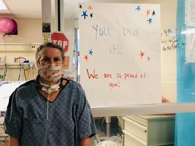 Beth Lacey Dearman stands in front of an encouraging sign at Mercy Medical Center in Redding. She had been hospitalized due to the novel coronavirus.