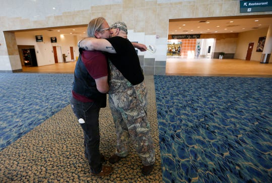 Vietnam War Army veterans Michael Jacobson (left) and Patrick Clark become emotional as they embrace while being reunited after not having seen each other since 1980 on Tuesday, May 5, 2020. Jacobson traveled from Idaho to Springfield to spend the week with his friend at Clark's home in Dunnegan.