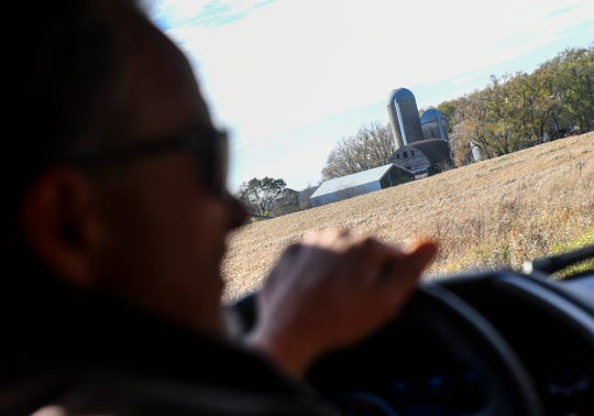Billy Dinkel drives past the farmstead where he grew up Saturday, Oct. 26, 2019, near Long Prairie.