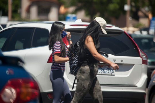 Shopper and staff wear masks at St. George grocery stores Friday, May 8, 2020.