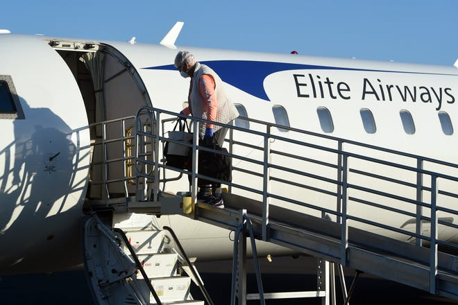 Passengers board an Elite Airways flight headed to Portland, Maine on Friday, May 8, 2020, at the Vero Beach Regional Airport. In March, the city ended an agreement with Elite that would allow it to fly out of Vero Beach, but the FAA says commercial airports can't prohibit an airline from landing at the airport. On Tuesday, the City Council adopted a new fee schedule that allows any commercial airline to be a designated airline and use the terminal facilities.