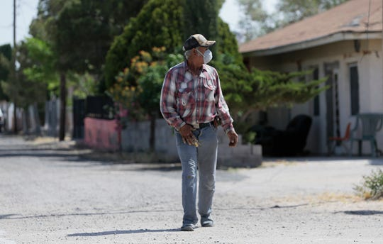 Fort Hancock resident Cruz Gonzalez takes a walk in his mask Friday. Hudspeth County has yet to see a positive coronavirus case.