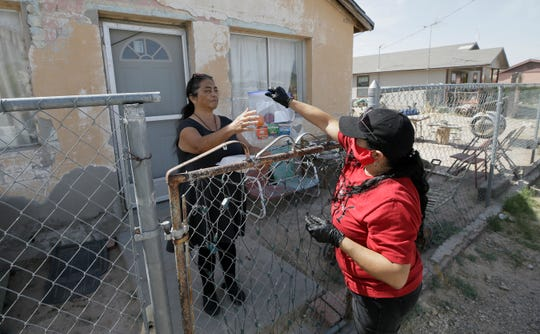 Cookie Grajeda delivers food to Lorena Grajeda during the coronavirus scare in Fort Hancock, Texas, Friday, May, 8, 2020. The town has yet to see a COVID-19 case.