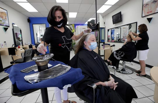 Ellen Germany finally has her hair colored and cut after a long beauty salon closure due to coronavirus. Markham Salon at 2200 N. Yarbrough reopened Friday to the delight of many who visited the salon.
