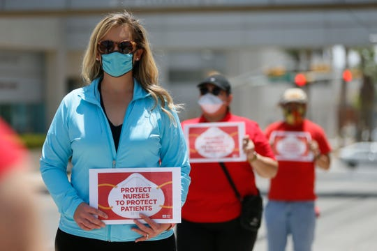 Las Palmas Medical Center registered nurse Ashley Bartholomew is joined by other nurses in El Paso on Friday, May 8, 2020, to protest what they say was retaliation against her for speaking publicly about her concerns over COVID-19 safety measures. She was suspended for three days after objecting to what she considered an unsafe assignment at the HCA hospital.