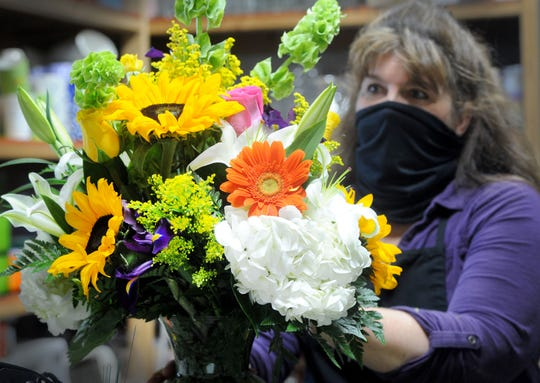 Della Dowler, owner of The Growing Co. in Ventura, prepares a Mother's Day flower arrangement on Friday, May 8, 2020. Florists were allowed to reopen with limited services amid the coronavirus pandemic.