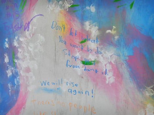 Positive, encouraging messages are being added to a mural next to Backdoor Theatre downtown.