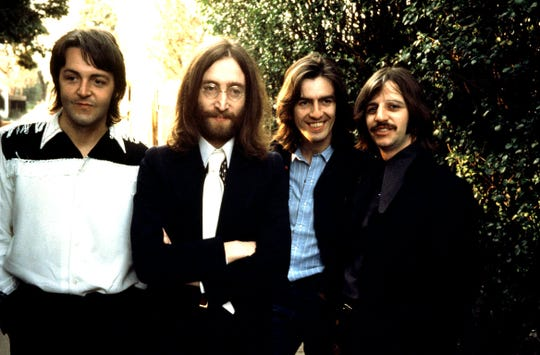 Beatles members Paul McCartney, left, John Lennon, George Harrison and Ringo Starr photographed together in April 1969.