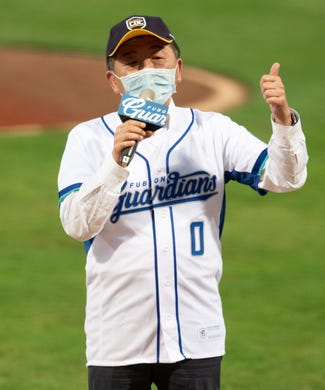 Commander of National Health Command Center Shih Chung Chen send regards prior to the CPBL game between Rakuten Fubon Guardians and Uni-Lions at the Xinzhuang Baseball Stadium on May 8, 2020 in New Taipei City, Taiwan. The CPBL lets 1000 fans in the stadium for the first time after the new season started behind closed doors.