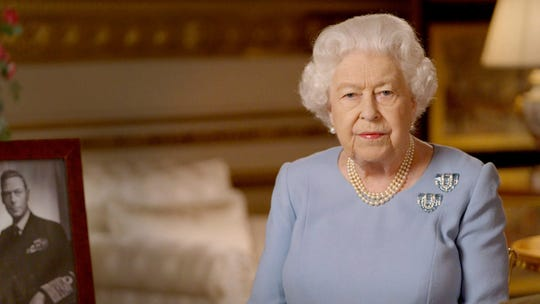 In this image taken from video and made available by Buckingham Palace, Queen Elizabeth II addresses the nation and the Commonwealth on the 75th anniversary of VE Day, from Windsor Castle, May 8, 2020.