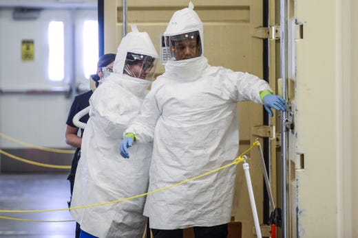 Battelle decontamination technicians Zachary Leiman, left, and Rod McCollum prepare to test a Battelle CCDS Critical Care Decontamination System on May 8, 2020 in Brighton, Colorado. The decontamination system can process up to 80,000 used N95 respirators per day using vapor phase hydrogen peroxide that kills coronavirus and allows masks to be reused 20 times without degradation.
