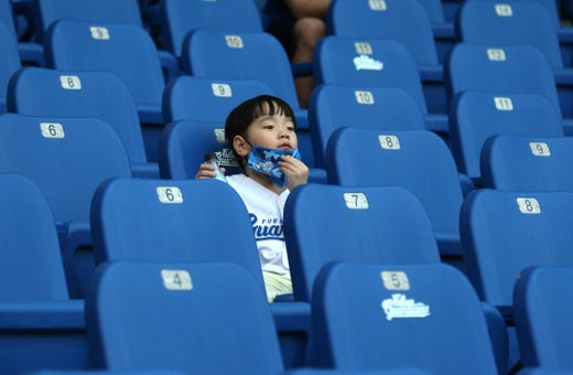 A young fan sits in the stands at Xinzhuang Baseball Stadium in New Taipei City, Taiwan, Friday, May 8, 2020.