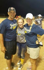 Gary and Erica Jones pose with their daughter, Hanna, following a softball game.