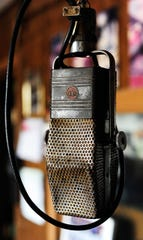 A 1940s model RCA radio microphone in the control room at KVMC/KAUM in Colorado City in 2012. It served as the inspiration for the large microphone sculpture outside the station built by station engineer Porter Richardson in the 1960s.