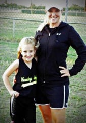 Softball coach Erica Jones poses with her daughter, Hanna, during her early playing days in Hawley.