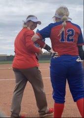 Jim Ned softball coach Erica Jones talks with daughter Hanna Jones, a member of the team.