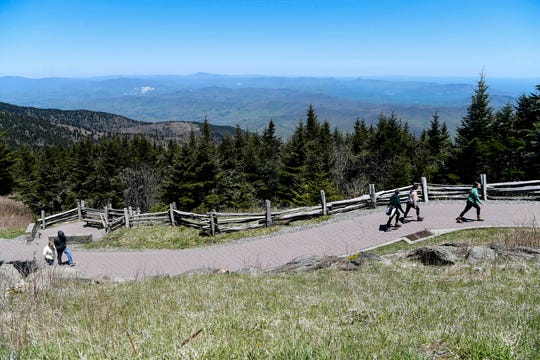 People walk to the peak of Mount Mitchell, which was recently reopened, May 9, 2020.