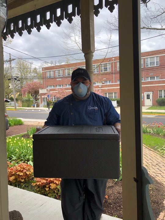 Chef David Murray makes a delivery of Denim BYOB food to a customer. Since Easter, the Haddonfield restaurant has offered curbside takeout, local delivery as well as groceries.