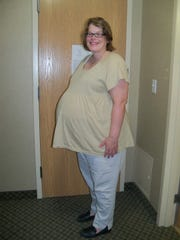 Anne Pairan, pregnant with triplets, in 2013.