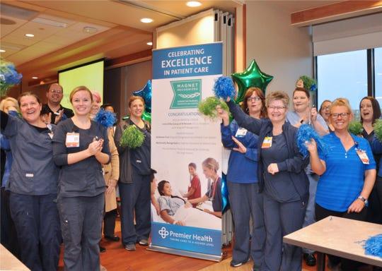 Atrium Medical Center team members celebrating an award from the American Nurses Credentialing Center.