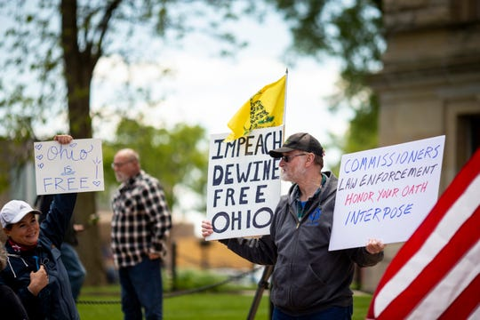 People gather to protest the handling of the pandemic by Governor Mike DeWine and Dr. Amy Acton, director of the Ohio Department of Health, at the Butler County Courthouse in Hamilton, Ohio on Saturday, May 9, 2020.  Free Ohio Now protests happened simultaneously across the state.