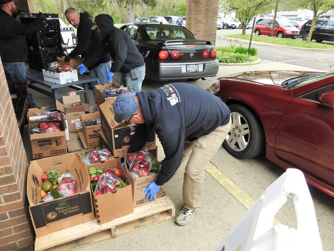 Fresh produce was distributed recently at the Coshocton Senior Center through a curbside pickup method. Previously, participants would pick food themselves inside the center, but the building is closed to the public due to the COVID-19 pandemic.