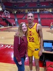 Brenda Haliburton and her son, Tyrese, a potential NBA Draft lottery pick and former Iowa State star, stand by the court after Iowa State's game at Texas Tech last season. Brenda attended every one of her son's games last year.
