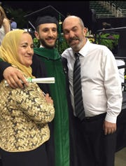 Abdelfattah Abdrabbo (on right) with his son Dr. Mohammed Abdrabbo (center) and his wife Aziza Abdrabbo at his son's commencement at Michigan State University's Medical School in 2017. Abdrabbo died on April 27, 2020, after testing positive from the coronavirus .