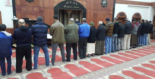 Standing in front, Abdelfattah Abdrabbo, of Canton, leads prayer at Masjid Al-Salaam, a mosque in Dearborn. He died of the coronavirus on April 27, 2020, at the age of 65.