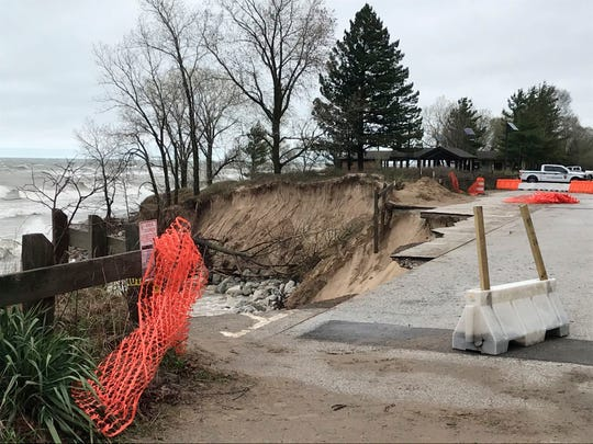 Parking was seen washed away on April 30 in Beverly Shores, Ind. after strong overnight waves. Waves from Lake Michigan have washed away a section of pavement in a Northwest Indiana town, threatening utility lines and nearby homes.