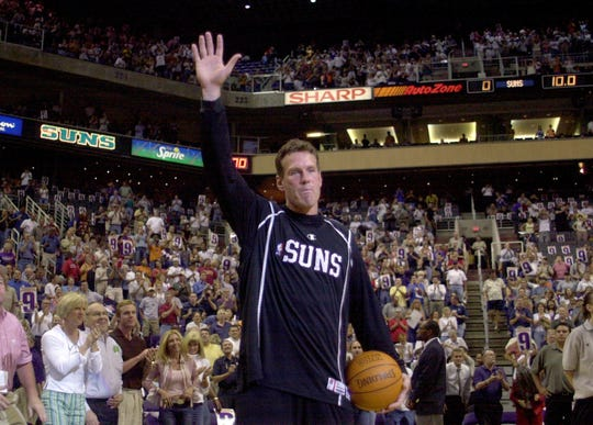 Suns guard Dan Majerle waves farewell to fans prior to the start of his final game of his career against the Dallas Mavericks after 14 seasons in the NBA Wednesday, April 17, 2002, at America West Arena in Phoenix.