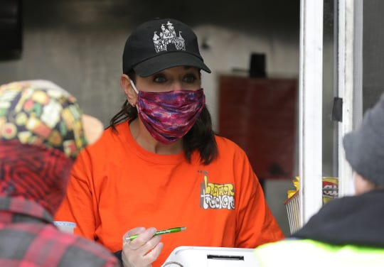 Marc's wife Jennifer Kellman waits on costumers at the Brother Truckers food truck in this White Lake neighborhood on May 8, 2020.