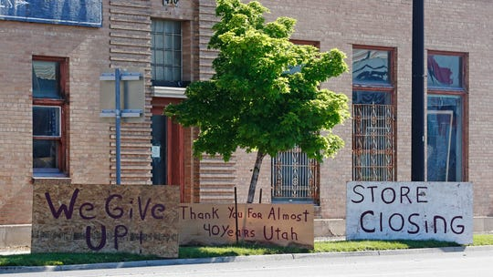 Store closing signs are shown in front of Euro Treasures Antique store Friday, May 8, 2020, in Salt Lake City.