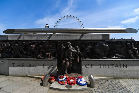 Wreath are left at the memorial of the Battle of Britain in London, Friday, May 8, 2020 on the 75th anniversary of the end of World War II in Europe.