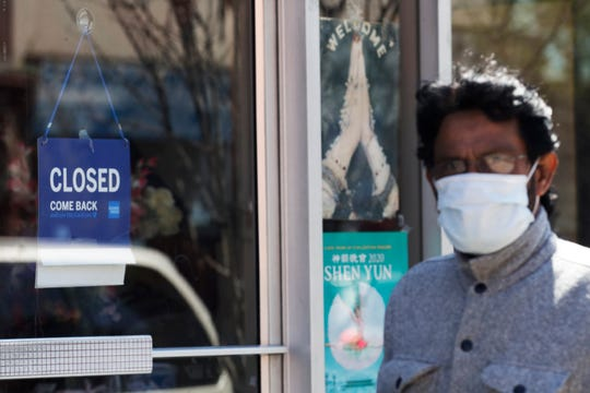 A closed sign shows at the store in Chicago, Friday, May 8, 2020. More than one million unemployment claims have been processed in Illinois since beginning of COVID-19 pandemic.