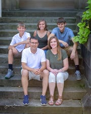 Clyde's Jennifer Hohman, bottom right, is joined by husband Barry, son Seth, back right, and twins Sidney and Shane.
