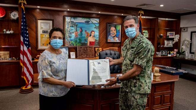 U.S. Pacific Fleet Commander Adm. John Aquilino presented Guam Gov. Lou Leon Guerrero with the Navy Distinguished Public Service Award May 2.