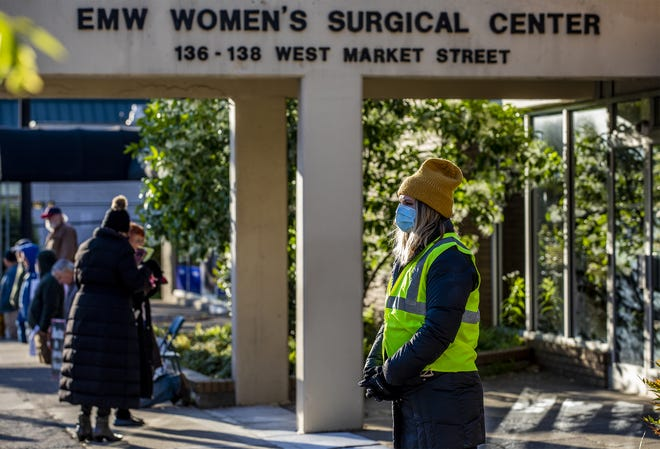 A woman who did not want to be identified waited to pray with people who were entering the EMW Women's Surgical Center during an anti-abortion rally in Louisville. May 9, 2020.