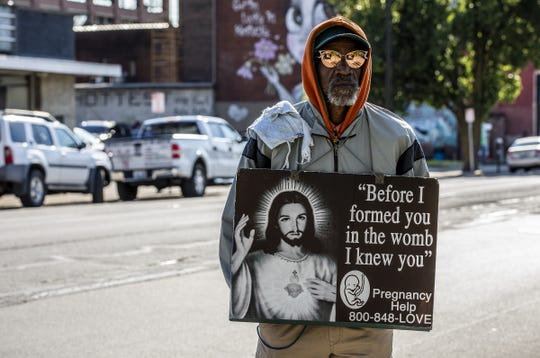 Douglas Lyles of Louisville, Ky. stood in the street in front of the EMW Women's Surgical Center during an anti-abortion rally in Louisville. May 9, 2020
