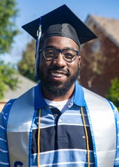 Antonio Scott, outgoing Student Government Association President at the University of Memphis, poses for a portrait in front of his home in Cordova, Tenn., on Saturday, May 9, 2020.