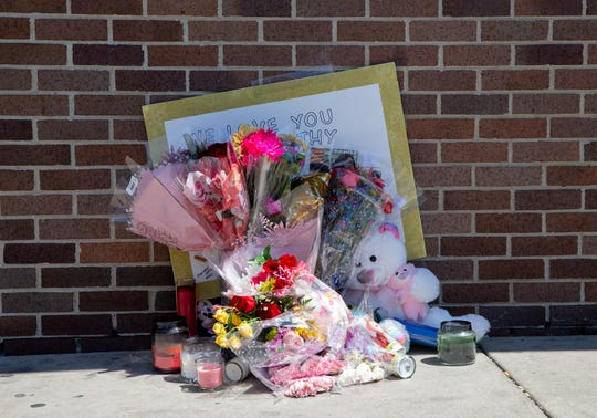 A memorial is set up outside the Walgreens for worker Cathy King, who was shot and killed Tuesday outside the store at 2727 W. North Ave.